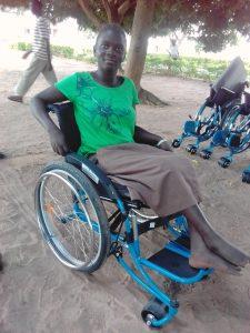 Girl happy with wheelchaira